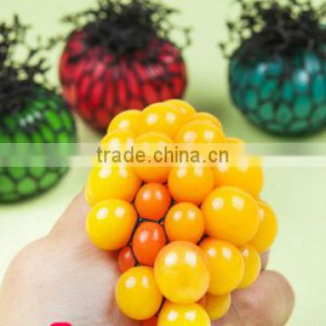 Hot selling creative trick-playing toy yellow rubber chicken lays eggs toy, plastic keychain toy