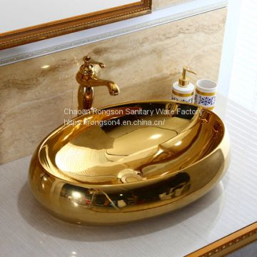 Oval gold colorful art above counter basin sinks bathroom