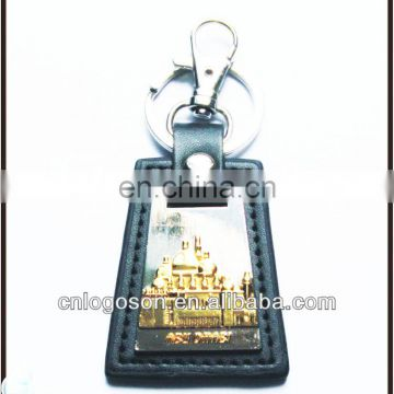 collection dubai souvenirs items metal and leather key chain