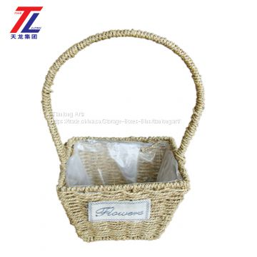 wholesale cheap grass braid stitched natural gift straw basket with handle
