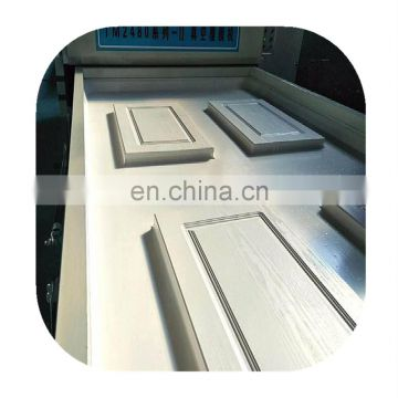 Automatic wood grain transfer printing machine for doors