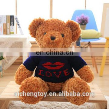 lovely sitting brown plush long fur teddy bear with sweater