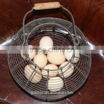 Oval metal wire storage basket with wooden handle