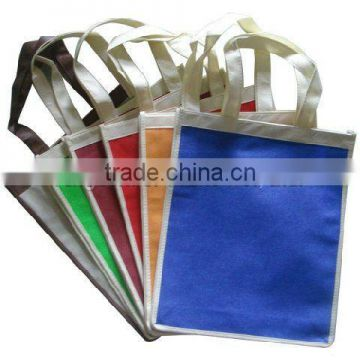 Nonwoven handled bag