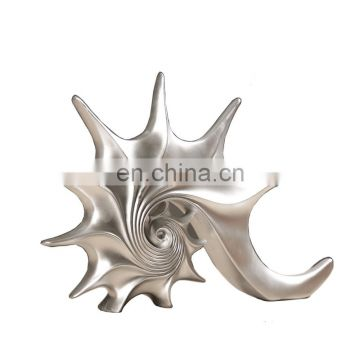 silver conch figure sea animal souvenir