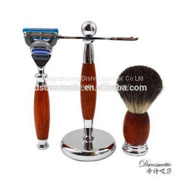 red wooden shaving kit with shaving stand brush and razor