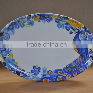 porcelain fish plate with peacock decal