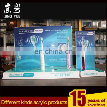 Factory custom L shape pmma plexiglass acrylic rechargeable electric sonic toothbrush display stand