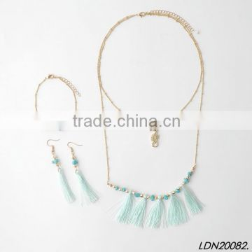 Double pendant hippocampi and turquoise with tassel necklace with matching earrings and bracelet