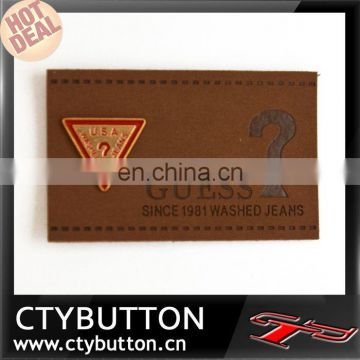 Inverted triangle pattern embossing brand name for clothing