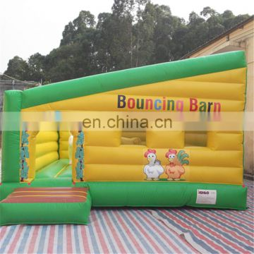 Yellow bouncers inflatables, barn/farm bounce houses