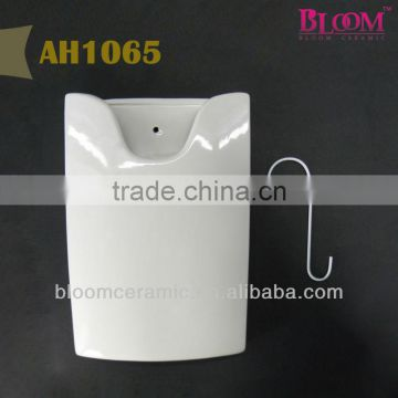 "White ceramic hanging humidifier with metal ""S"" hook"