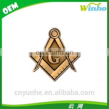 Winho antique gold die struck masonic badge