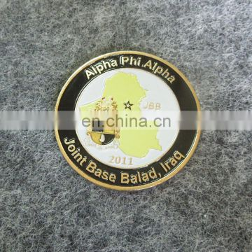 Gold tone metal commemorate coin for Iraq