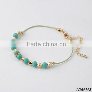 faced green glass cord bracelet