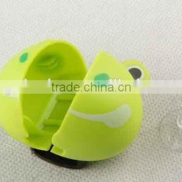 Frog shaped plastic toothbrush holder