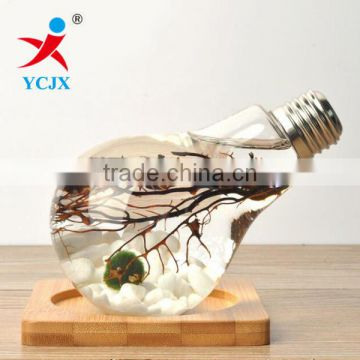 Hand Blown Glass Bulb Bottle with Silvery Metal lids and Wood Base