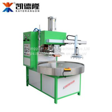 Automatic 4 position round plate blister packing machine with robot hand