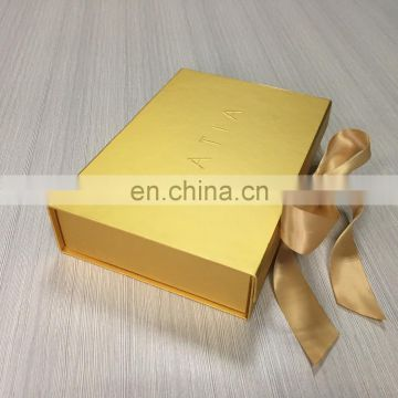 Very shiny gold printing flat rigid box with embossed logo match gold bow for gift packed