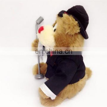 Taking the microphone wearing suit Electric plush bear toys singing bear