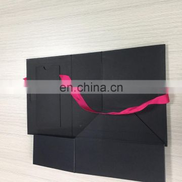 All black flat box with gold foil paper box inside lid have pocket can holder holder