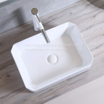 Latest design bathroom ceramic art oval wash basin outdoor low price counter top popular special no hole sink for sale