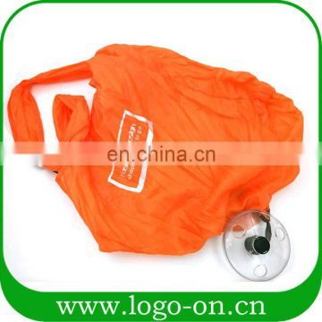 New design reusable shopping bag to roll up with round shaped plastic case