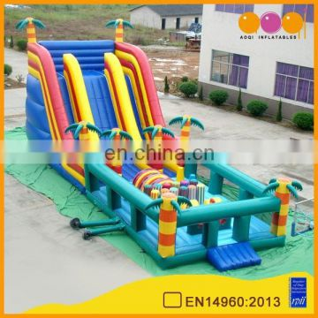 AOQI torrid zone high inflatable slide obstacle for sale