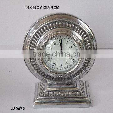 Round table clock with fulted patterns in mirror polish Finish and alos available in nickel plating
